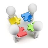 14573945-3d-small-people--team-with-multi-colored-puzzles-3d-image-isolated-white-background